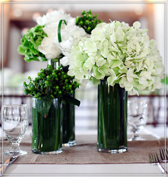 Green vases with brown branches, white china, Brass Candlestick in Wisconsin
